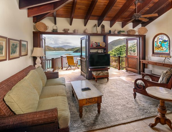 Living Room and Balcony Surrounded by Turquoise Caribbean Bays